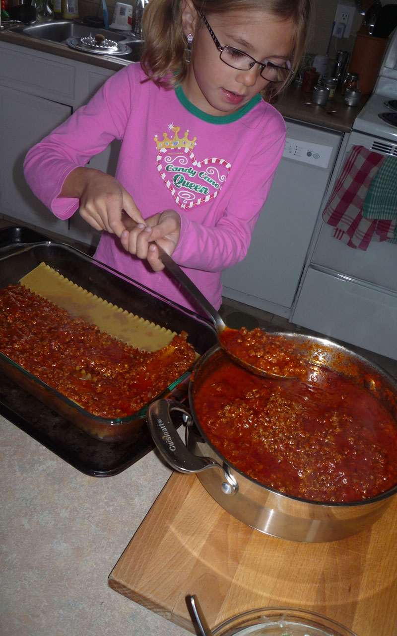 Here is my mini chef H adding the sauce on the noodles.