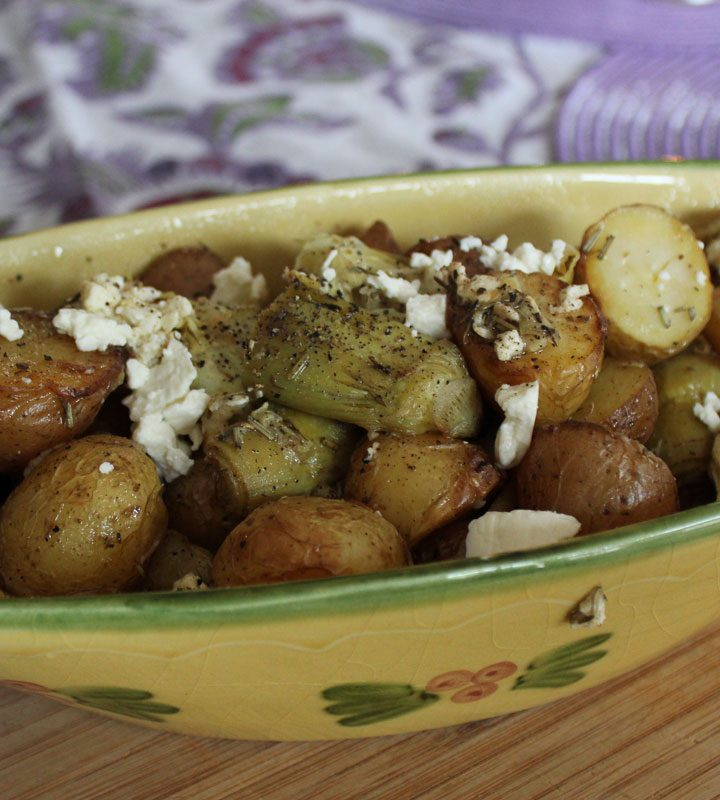 Slow roasted potatoes with artichoke hearts and salty feta