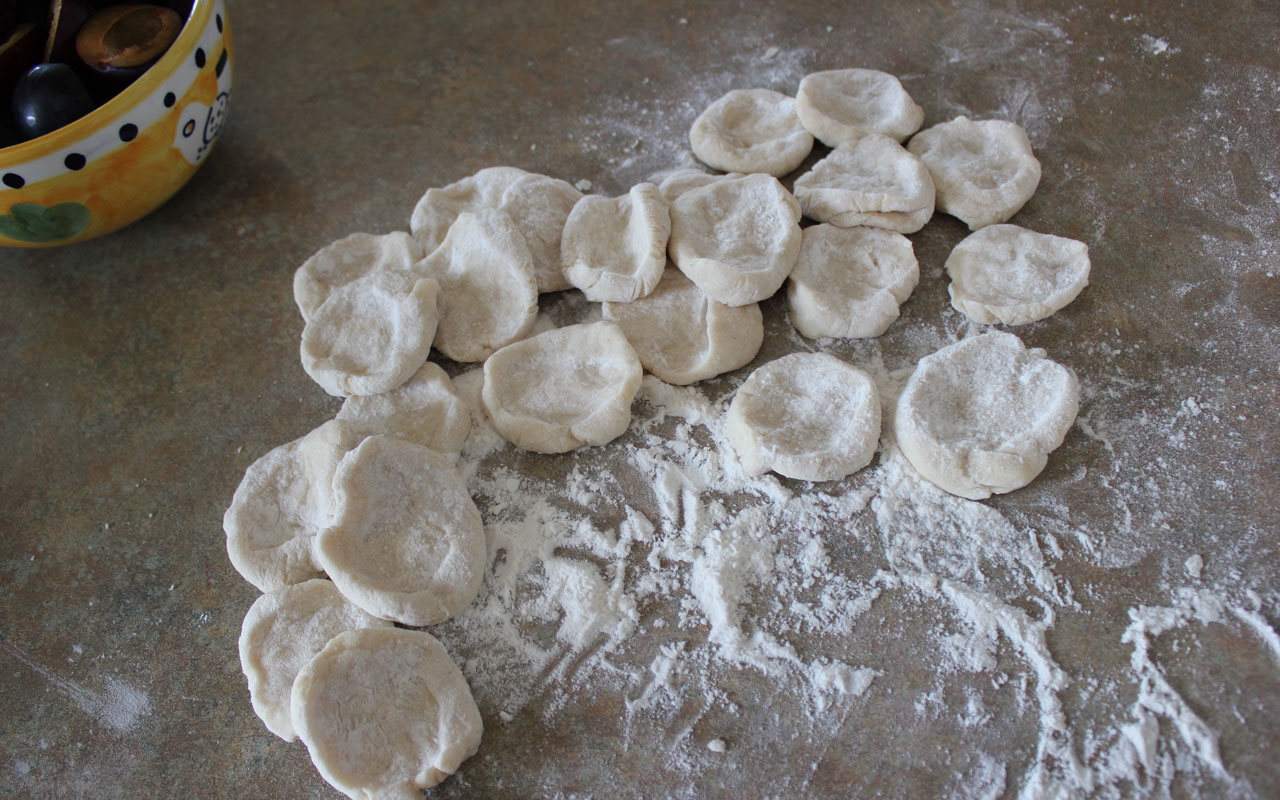 Pierogi dough flattened and ready for rolling