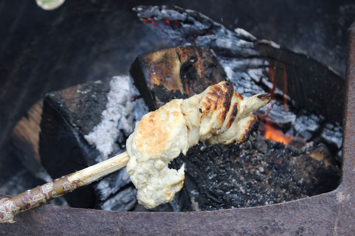 Cooking Bannock over the camp fire
