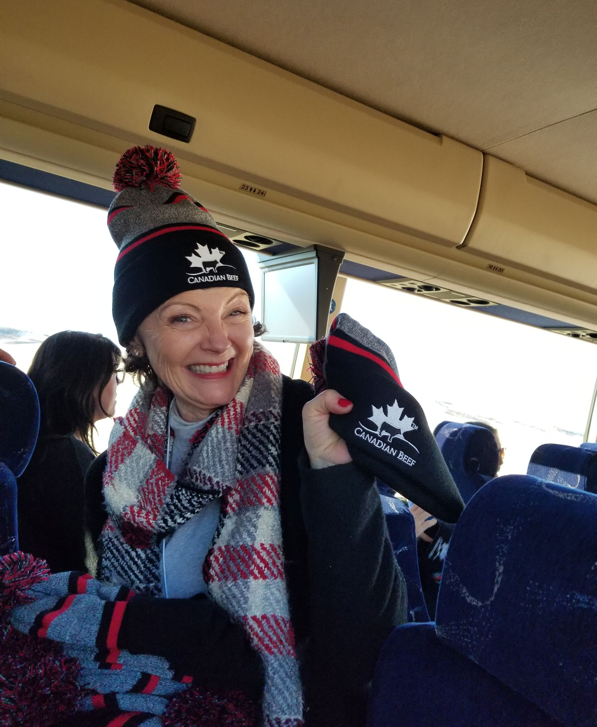 Mairlyn Smith handing out toques