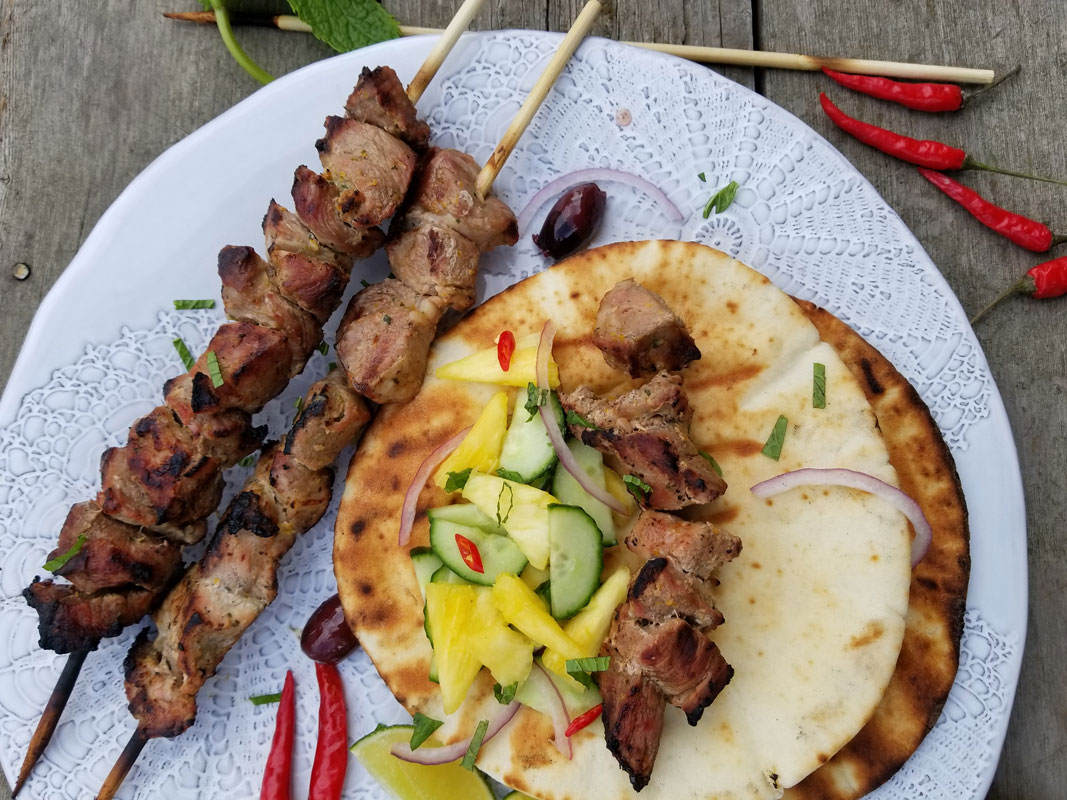 Pork Souvlaki on pita with cucumber pineapple salsa