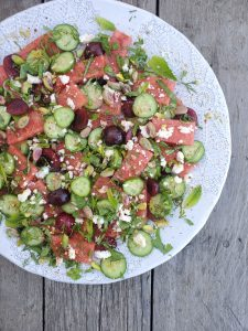 A refreshing salad for summer includes watermelon herbs and cucumber