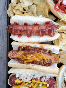 Try some new toppings when you make a grilled sausage bar